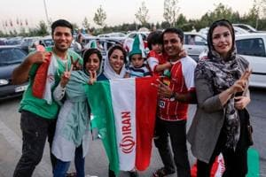 Iranian football supporters dressed in their national team