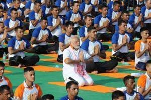 Prime Minister Narendra Modi performs yoga on International Yoga Day in Dehradun in Uttarakhand on Thursday.