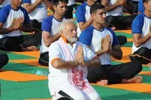 Prime Minister Narendra Modi performs yoga on International Yoga Day in Dehradun.