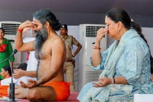 Yoga guru Ramdev Baba and Rajasthan chief minister Vasundhara Raje perform yoga during an event to set the Guinness World Record for
