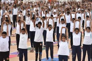 More than 8,000 National Cadet Corps (NCC) cadets perform yoga on the occasion of the 4th International Yoga Day at the Field Marshal Manekshaw Parade ground in Bengaluru on Thursday.