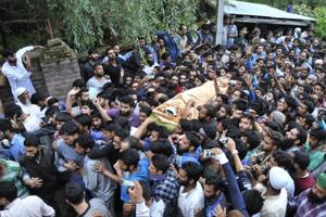 Kashmiris carry the body of Hizbul Mujahideen commander Burhan Wani during his funeral procession in Tral on July 9, 2016. The killing of Wani, considered a hero among locals, sparked months of unrest in the Valley, pitting civilians against security forces and leading to scores of deaths and dozens more injured.