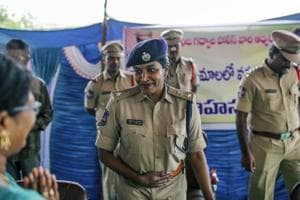 IPS officer Rema Rajeshwari interacts with people during a public awareness programme for fake news via social media apps in Balgera village in Gadwal district of Telangana.