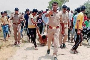 Hapur SP Sankalp Sharma said the photo was taken after the incident and, seen in it are villagers taking Kasim to an ambulance on the direction of the policemen.