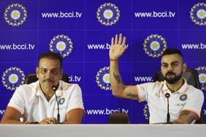 Indian cricket team captain Virat Kohli, right, and head coach Ravi Shastri address the media ahead of the team's travel to England and Ireland on Friday.