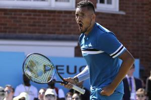 Nick Kyrgios of Australia celebrates winning his quarterfinal tennis match against Feliciano Lopez of Spain at the Queen