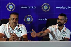 Indian cricket team head coach Ravi Shastri (L) watches as captain Virat Kohli speaks during a press conference in New Delhi on June 22, 2018.