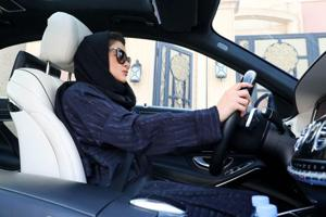 (FILES) In this file photo taken on April 29, 2018, a Saudi woman practices driving in Riyadh, ahead of the lifting of a ban on women driving in Saudi Arabia in the summer.