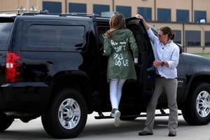 """U.S. first lady Melania Trump climbs into her motorcade vehicle wearing a Zara design jacket with the phrase """"I Really Don"""