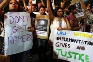 Women hold a protest against the incidence of rape in Ahmedabad, in April 2018.