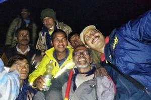 Uttarakhand State Disaster Response Force personnel take a selfie with 67-year-old trekker S Prema Chandran from Thiruvananthapuram after rescuing him from Chamoli district.