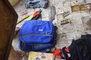 A school bag belonging to the accused was found on the terrace of a temple near the school building. It contained three big knives and a bottle filled with red chilli solution.
