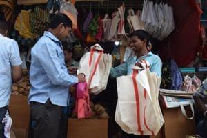 A man at a cloth bag shop in Thane.
