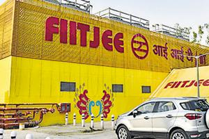 A general view of IIT Delhi metro station, displaying the name of FIITJEE coaching institute, in New Delhi.