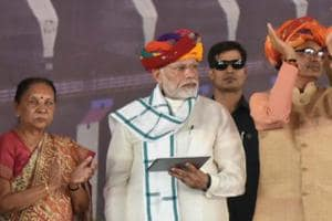 Prime Minister Narendra Modi with Madhya Pradesh Governor Anandi Ben Patel (left) and chief minister Shivraj Singh Chouhan (right) during the inauguration ceremony of Mohanpura dam project in Rajgarh district, Madhya Pradesh, on June 23, 2018.