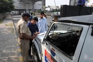 Gurugram traffic policeman fines a commuter on the MG road.