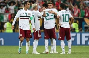 Mexico players celebrate after the match vs South Korea. Mexico won 2-1.