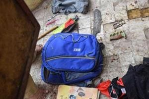 A school bag belonging to the accused was found on the terrace of a temple near the school building inVadodara. It contained three big knives and a bottle filled with red chilli solution.