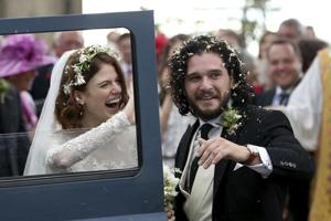 Actors Kit Harington and Rose Leslie react as they leave after their wedding ceremony at Rayne Church, Scotland on Saturday.