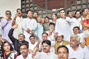 Madhya Pradesh Congress MLAs stage a protest at the state assembly in Bhopal.