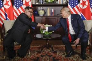 US President Donald Trump shakes hands with North Korea leader Kim Jong Un (left) during their first meeting at the Capella resort on Sentosa Island on June 12 in Singapore.