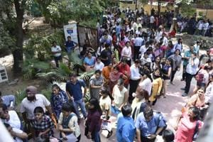 Delhi university aspirants stand in queues to get admission in new academic session 2018-19 at Daulat Ram College in New Delhi on June 20, 2018.