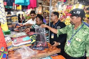 TMC officials inspect shops at Gaondevi Market in Thane on Saturday