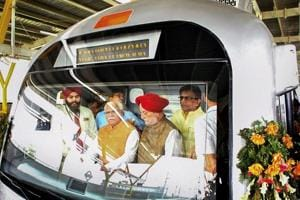 Haryana chief minister Manohar Lal Khattar and Union urban affairs minister Hardeep Puri in the cockpit of a metro train after the inauguration of the Mundka-Bahadurgarh section of the Delhi Metro