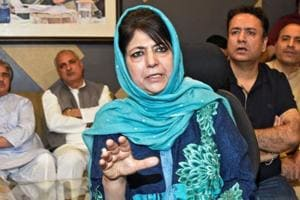 Former Jammu and Kashmir Chief Minister Mehbooba Mufti gestures as she addresses a news conference in Srinagar on June 19.