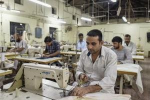 Prisoners stitch clothes in a tailoring unit in Tihar, India's most crowded prison.