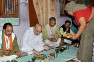 BJP national president Amit Shah (2nd from left) along with chief minister Trivendra Singh Rawat had lunch at a Dalit