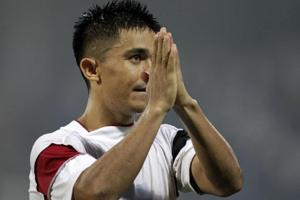 Sunil Chhetri, captain of the Indian football team, acknowledges fans' support during the Intercontinental Cup final match, in which India beat Kenya 3-0.