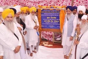 SGPC president Gobind Singh Longowal (R) and Akal Takht jathedar Giani Gurbachan Singh (L) launching the 'kar sewa' at the Golden Temple Langar hall in Amritsar on Sunday.
