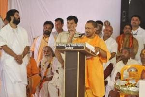Chief minister of Uttar Pradesh Yogi Adityanath speaks during the 80th birthday celebration of Mahant Nritya Gopal Das in Ayodhya, Uttar Pradesh, on Monday.