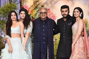 Indian Bollywood film producer and director Boney Kapoor (C) poses for a picture with his daughters Janhvi Kapoor (L), Anshula Kapoor (2L) and Khushi Kapoor (R) and son Arjun Kapoor (2L) during the wedding reception of actor Sonam Kapoor and businessman Anand Ahuja in Mumbai late on May 8, 2018.