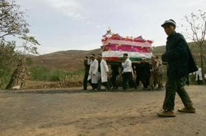 Family members carry the coffin of the dead during the funeral of a senior citizen in Jiaodai Township on October 27, 2005 in Lantian County of Shaanxi Province, China.