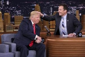 US President Donald Trump appears with host Jimmy Fallon during a taping of The Tonight Show Starring Jimmy Fallon, in New York. Fallon is opening up about the personal anguish he felt following the backlash to his now-infamous hair mussing appearance with Donald Trump. Trump opponents criticized Fallon for a cringeworthy interview only weeks before the election where Fallon playfully stroked Trump's hair.