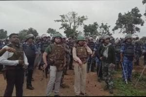 Police fired tear gas shells and used batons to disperse a mob obstructing their search operation to rescue three policemen, who were abducted from an MP's house in Khunti district by 'Pathalgadi' supporters.