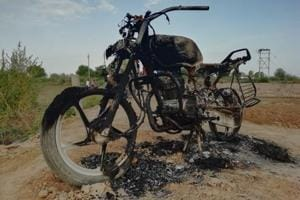A motorcycle that was set ablaze during a clash between two villages at Hansi in Hisar district on Monday.