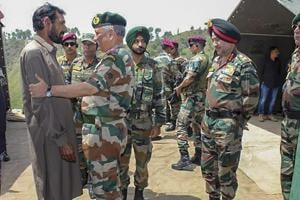 Chief of Army Staff, General Bipin Rawat meets the family members of late rifleman Aurangzeb at his village Salani in Poonch district of Jammu on June 18, 2018. Aurangzeb was abducted and later killed by militants in Gusoo village of south Kashmir's Pulwama district on June 14.