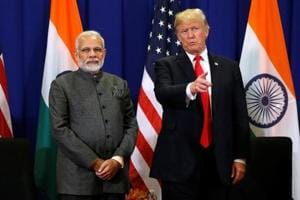 US President Donald Trump with Prime Minister Narendra Modi in Manila. Trump wants India to cease its oil trade with Iran, and has threated India -- as well as China -- with sanctions