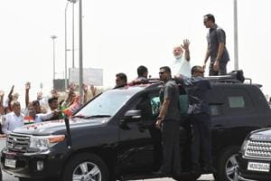 Prime Minister Narendra Modi waves to his supporters after inaugurating the Delhi-Meerut National expressway on  May 27, 2018.