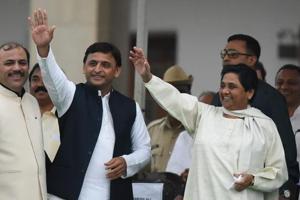 Samajwadi Party leader Akhilesh Yadav along with Bahujan Samaj Party chief Mayawati during the swearing-in ceremony of HDKumarswamy as the 24th chief minister of Karnataka at Vidhan Soudha in Bengaluru, on May 23, 2018.