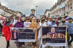 Journalists hold placards during a silent protest march against the killing of Rising Kashmir newspaper editor-in-chief Shujaat Bukhari, in Srinagar on Tuesday.
