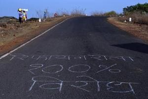 """Farmers and residents have chalked roads all along the border of Sindhudurg and Ratnagiri districts in Maharashtra, with """"The refinery will not be constructed here."""