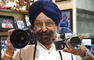 Tejbans Singh Jauhar of Tejee's Studio, Sector 17, showing a latest and a vintage camera.
