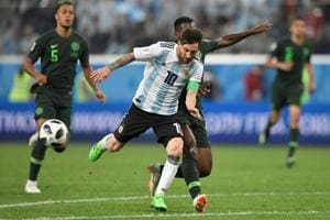 Lionel Messi (C) competes for the ball during the 2018 FIFAWorld Cup Group D match between Nigeria and Argentina at the Saint Petersburg Stadium in Saint Petersburg on June 26, 2018.