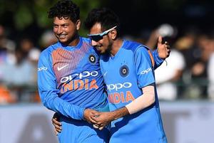 Kuldeep Yadav (L) took four wickets inIndia's 76-run win over Ireland in the first T20 in Dublin.