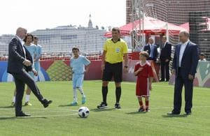 Russian President Vladimir Putin (R) and FIFA President Gianni Infantino (L) take part in the opening of an exhibition soccer match in the World Cup Football Park in Red Square in central Moscow, Russia on June 28, 2018