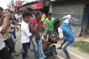 A mob in West Bengal's Malda attacking a man on June 22. Police rescued him and admitted him to hospital.